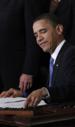 Obama-smirk-signing-obamacare