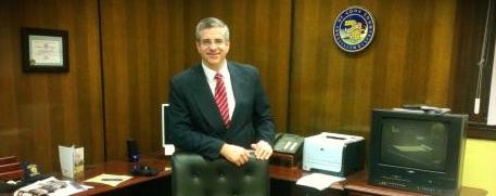 Dan Patlak standing at desk wide shot