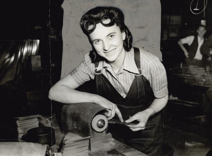 1941 photo of woman at grinding wheel