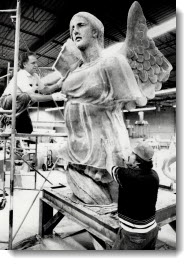 Another goddess: Noberto Cardosa, left, and Raoul Guillen apply reinforcing material in production of a replacement for the seven-metre Winged Goddess which had stood for nearly 60 years at the Canadian National Exhibition. 1987