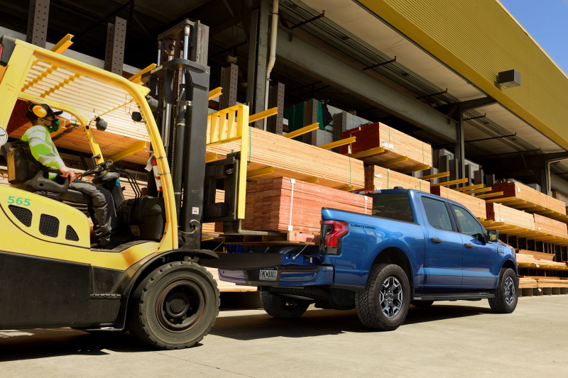 2022 Ford F-150 Lightning Getting Loaded With Lumber