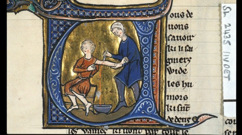 A manuscript illumination shows two people in medieval clothing, one using a scalpel to open a wound in the left arm of the other, for bloodletting.