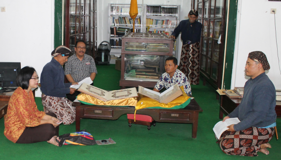 Looking at manuscripts in the Widya Budaya library in the palace ofYogyakarta, with royal librarian K.R.T. Rintaiswara (second left) and staff of the Libraries and Archives Board of Yogyakarta. Photo by A.T. Gallop, 24 September 2016