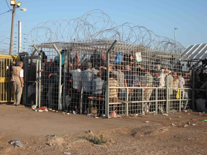 Ephraim/Taybeh checkpoint, West Bank, Occupied Palestine (photo:David Heap/EAPPI) - See more at: http://mondoweiss.net/2014/01/palestinian-overcrowded-checkpoint.html#sthash.Nc77FXxJ.dpuf
