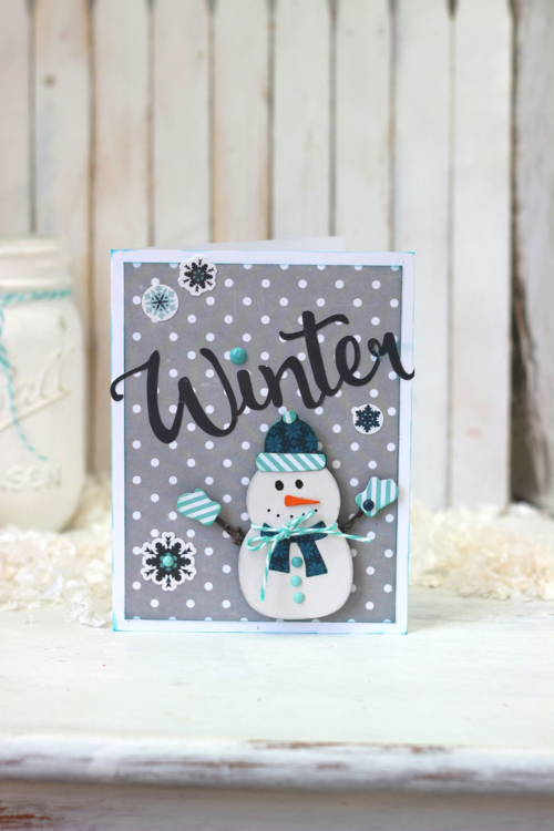 """Winter Time Card by Holly Gagnon with the """"Hello Winter"""" collection by #EchoParkPaper.  This card features designer dies, stickers, and enamel dots embellishing the cute snowman!"""