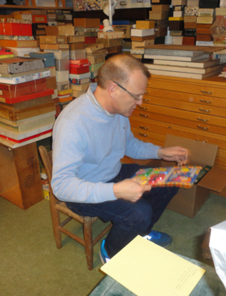 Nic ponders a puzzle to pack. Courtesy of The Strong, Rochester, New York.