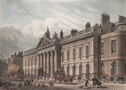 Colour photograph of East India House and the street outside bustling with pedestrians and horse and cart traffic