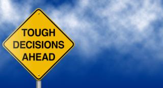 Tough decisions sign