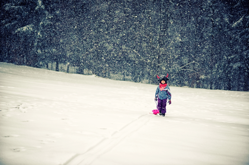 Girl-pulling-a-sled-in-snow
