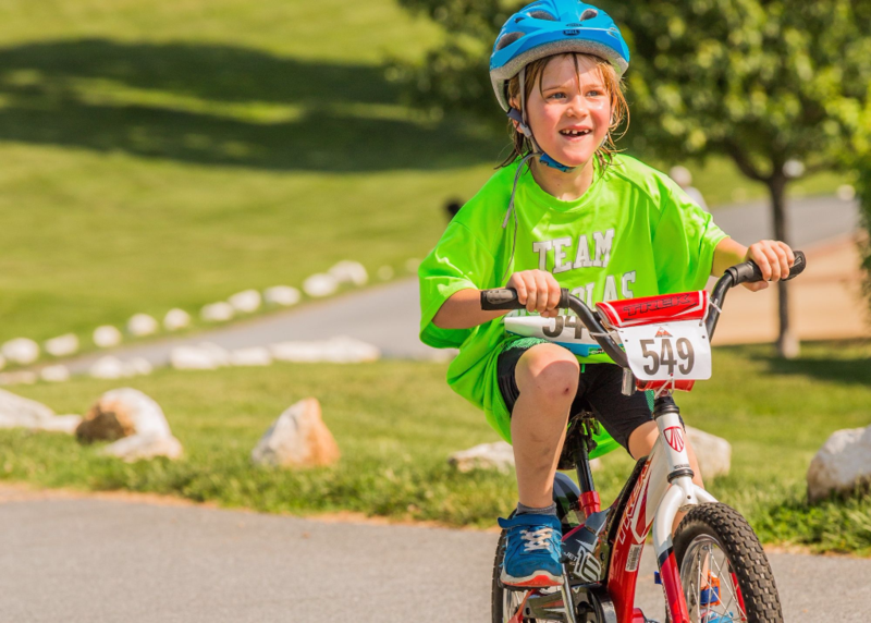 Biker in the 2015 JUST TRYAN IT Triathlon