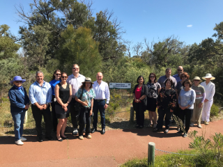 Alcoa of Australia Chairman and Managing Director Michael Parker toured Wireless Hill Reserve with other employees and representatives from Friends of Wireless Hill.