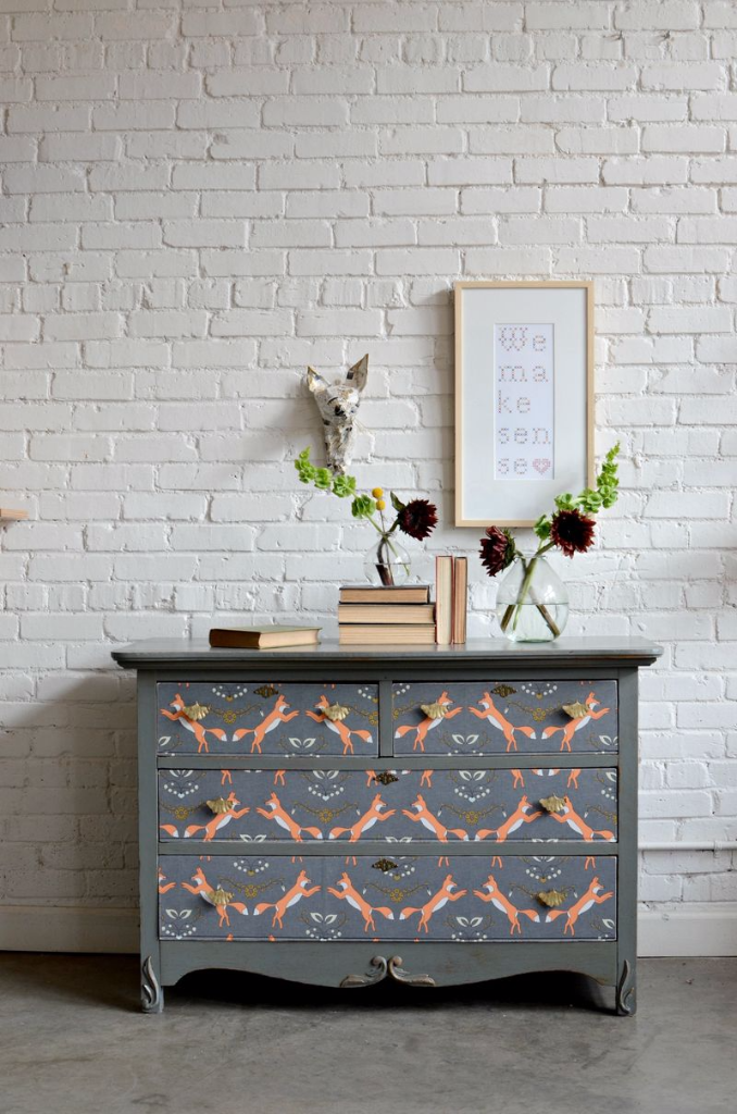 A refurbished dresser takes on a whole new look with the help of milk paint and Spoonflower wallpaper