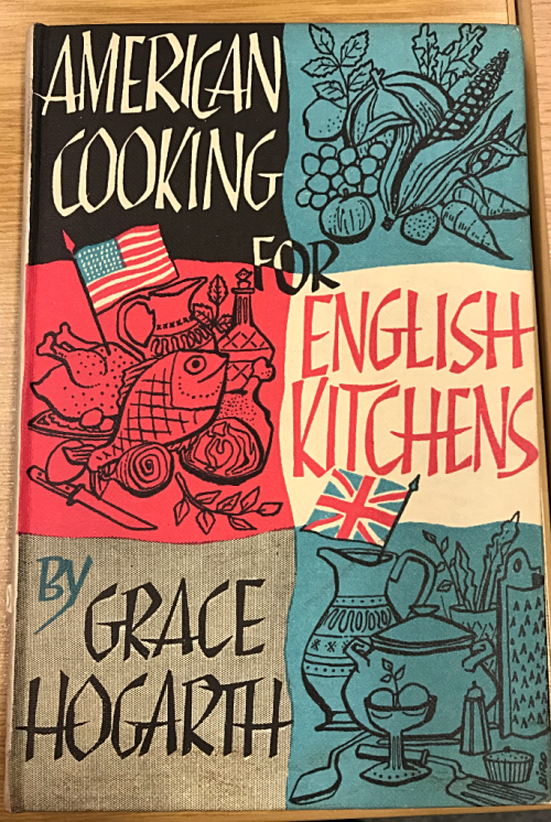 Photograph of Cover of American Cooking for English Kitchens by Grace Hogarth showing US flag and which includes illustrations of fruit, vegetables and meats