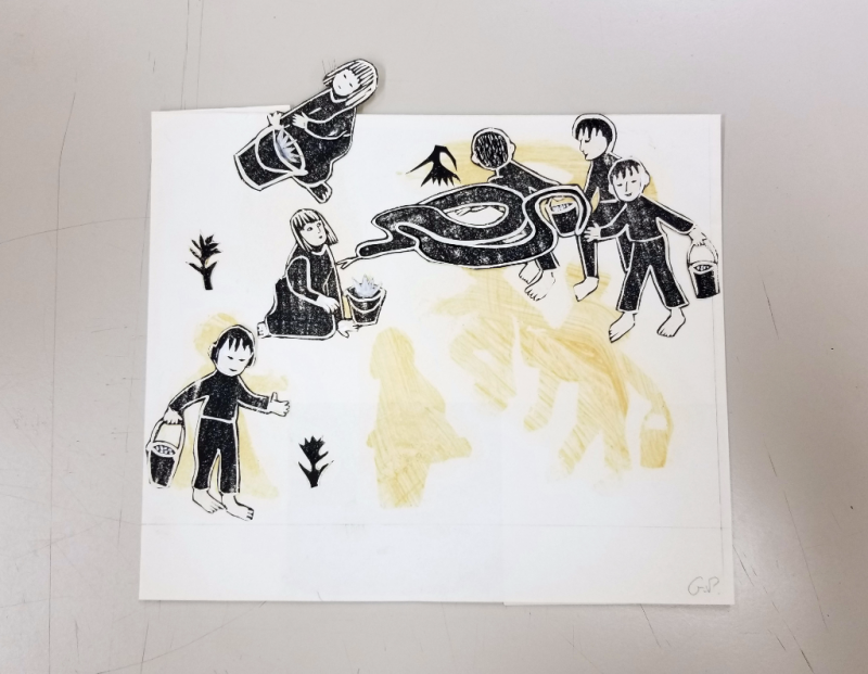 Cut outs of figures detached from piece of paper with residue of adhesive