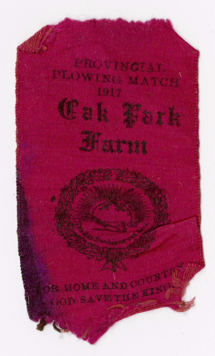 Red ribbon reading Provincial plowing match 1917  Oak Park Farm  For Home and Country  God Save the King